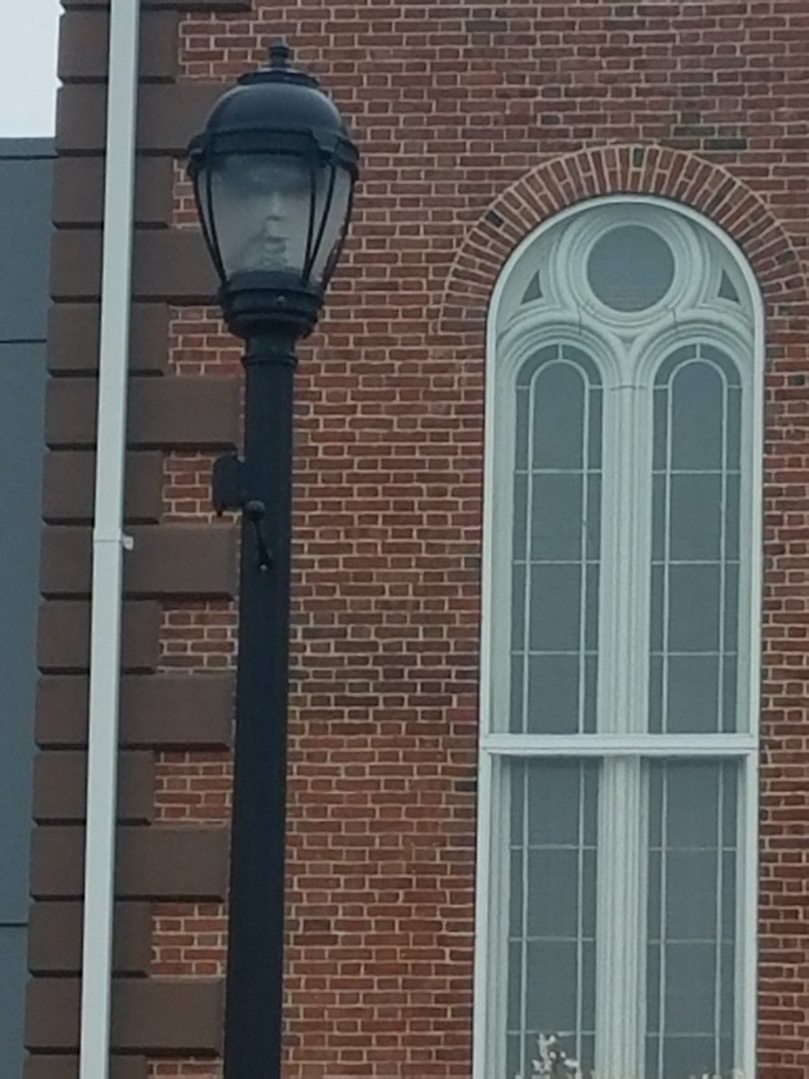 Ghostly 'face' seen in Salem street lamp sends chills online