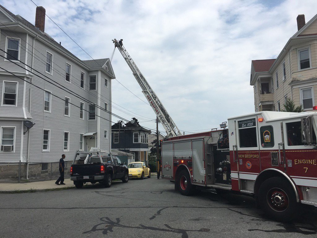 New Bedford Fire still on the scene 1 p.m. Saturday following a roof collapse due to the fire that occurred 12 hours prior.