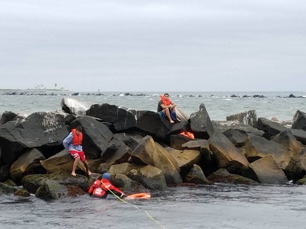 Coast Guard rescues two stranded teenage boaters from rock breakwater